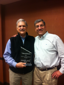 Dick Baur, Meadow Creek Sales, accepts the 2013 Vent-A-Hood Sales Award from Mark Klein, Director of Sales at Vent-A-Hood.
